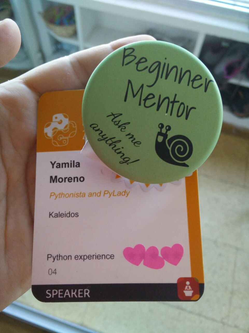 I was given this badge and I proudly showed it during the conference :D